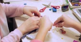 plasticina : Cute Little Children Sitting at the Desk Sculpts a Different Figures From Made of Colored Modeling Plasticine in the Nursery. Development of the Art of Modeling in Children. Stock Footage