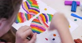 knetmasse : Cute Little Children Sitting at the Desk Sculpts a Different Figures From Made of Colored Modeling Plasticine in the Nursery. Development of the Art of Modeling in Children. Stock Footage