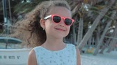 sunburn : Close-up Portrait of a Beautiful Little Girl in Pink Glasses, Cute Smiling, Looking at the Camera. Concept: Children, Childhood, Summer, Baby Girl. Stock Footage