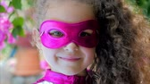 pelerin : Beautiful Llittle Girl in the Superhero Costume, Close Up Portrait Child in the Mask of the Hero.