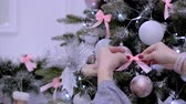 otvírák : Female hands close-up, hands decorate the Christmas tree with New Years toys. Christmas decorations, balls, lights, garlands, hang on the Christmas tree.