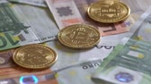 commerce : Golden Bitcoins And Euro Banknotes Rotating Stock Footage
