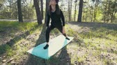 relaks : young pregnant woman doing yoga outside.