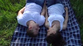 amor : Happy smiling couple lying on grass and relaxing