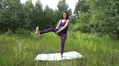 női : young pregnant woman doing yoga outside.