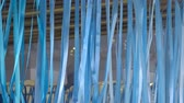 instalação : Beautiful blue ribbons hanging and swaying in the wind. Vídeos