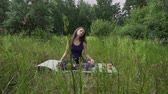 young pregnant woman doing yoga outside.