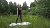 Beautiful pregnant woman doing sport in summer park. Stock Footage