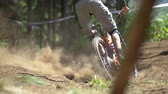 trough : Mountain bike racer speeding trough dusty track