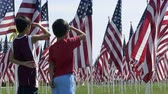 memorial : Boys saluting American flags Stock Footage