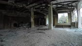 deserted : Moving in the interior of an abandoned ruined building.