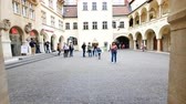 amblem : Bratislava, Slovakia, kid run inside the courtyard with a ballon