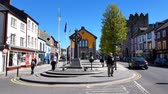 signage : People walking in the city center of Cashel, County Tipperary, Ireland Stock Footage