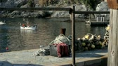 cascos : A fisherman is coming back home in the little town of Camogli, Italy Stock Footage
