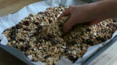 müsli : Hand of a woman touching homemade granola Stok Video
