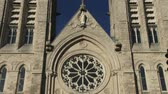 wiara : Towers and main door on the facade of the basilica of our Lady Immaculata in Guelph Ontario Canada. The church was built between 1875 and 1883 designated as National Historic Site of Canada in 1990 and designated basilica by Pope Francis in 2014 Wideo