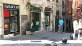 article : Tourists walking in the characteristic small streets in the old historic center of Genoa, Italy