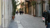 article : People walk in Via della Spiga, one of Milans top shopping street in the luxurious Fashion Quadrilateral, in Milan