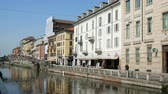 article : Buildings along the Naviglio Grande, part of a system of navigable and interconnected canals around Milan, Italy .. Stock Footage