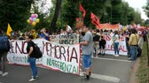 manifestação : Students hold banners during demonstration in Milan, Italy Vídeos