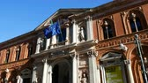 European and Italian flags wave on the main building of the Statale, a public university in Milan, Italy .. Wideo