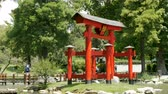 идиллический : Red pagoda in the Japanese Garden (Jardn Japons) in Buenos Aires, capital of Argentina. Стоковые видеозаписи