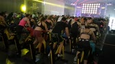 prática : Rimini, Italy - may 2019: Workout with Spinning Bike at Rimini Wellness 2019. Stock Footage