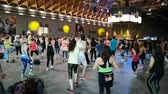 energy body : Rimini, Italy - June 2019: Fitness Workout in Gym - People doing Exercises during Public Event with Music, Dumbells and Teacher on Stage