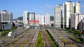 A train passing over the rail and a view around Yongsan Station in Seoul, South Korea.