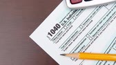 Pen on US TAX form Background. Tax Day concept. Stock Footage