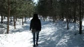 christmas angel : A teenager on a walk in winter nature. Stock Footage