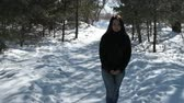 alone : A teenager on a walk in winter nature. Stock Footage