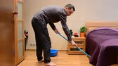 mopping : A young man cleaning floor