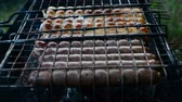 charbroiled : Barbecue browned sausages on the hot grill, a person turn and put upon brazier