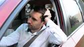 behind the wheel : Driver of a car being bored sitting in his vehicle waiting. Stock Footage