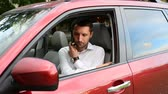 дилер : The man going across parking place and sits in his car and going away. Male open the door of the car, remove signaling