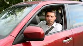 behind the wheel : Man Backs Up Into Parking Spot, In City, He Looks Over His Shoulder, Then Uses His Rearview Mirror