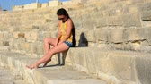 koloseum : Girl sitting on the steps of the old stadium