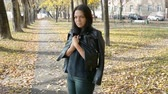 esperançoso : Young Beautiful Woman Walking In Autumn Park. Girl Walking In Forest In Fall, Lifestyle Concept Vídeos
