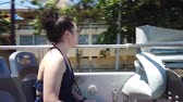 Girl goes on a sightseeing double-Decker bus on Varadero, Cuba