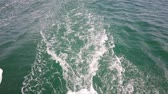 speedboat : A boat and the ocean. Camera On A Floating Boat. Waves At The Back Of The Boat. Stock Footage
