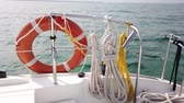 kruhy : Red life buoy over blue calm sea water background. Lifebuoy on the boat