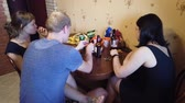 bar : MOSCOW, RUSSIA - JULY, 2019: Company of friends resting at home. Drink beer and cider, eat seeds. Dostupné videozáznamy