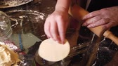 deegrol : Woman adds some flour to dough on table. Step by step cooking homemade dumplings guide.