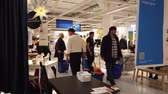 agd : MOSCOW, RUSSIA - NOVEMBER 17, 2019: People in largest furniture retailer IKEA showroom.