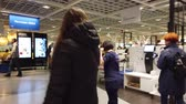 good time : MOSCOW, RUSSIA - NOVEMBER 17, 2019: People in largest furniture retailer IKEA showroom.