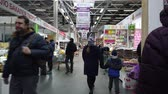 bakkaliye : MOSCOW, RUSSIA - NOVEMBER 23, 2019: People walk around the supermarket in search of the right products. People in the food market.