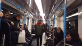 wagons : MOSCOW, RUSSIA - DECEMBER 12, 2019: People in the subway car. Moscow metro. Passengers sit in places with different activities. Stock Footage