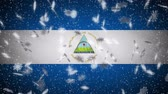 Nicaragua flag falling snow loopable, New Year and Christmas background, loop.
