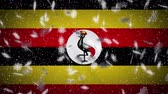Uganda flag falling snow loopable, New Year and Christmas background, loop Stok Video